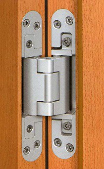 C mo reparar la bisagra de la puerta for Puertas que abren hacia afuera